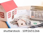 model house and dollar money... | Shutterstock . vector #1092651266
