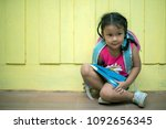child with backpack behind the  ... | Shutterstock . vector #1092656345