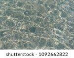 shimmering sun glares on pebble ... | Shutterstock . vector #1092662822