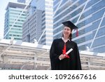 happy girl in her graduation... | Shutterstock . vector #1092667616