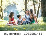 happy family in the park... | Shutterstock . vector #1092681458