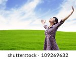 Carefree woman having a good time at the meadow - stock photo