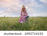 woman standing on meadow and...   Shutterstock . vector #1092714152