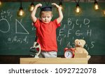child  pupil on calm face with... | Shutterstock . vector #1092722078
