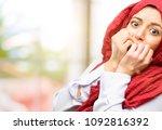 young arab woman wearing hijab...   Shutterstock . vector #1092816392