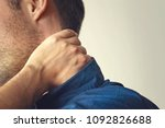 man with neck pain. young guy... | Shutterstock . vector #1092826688