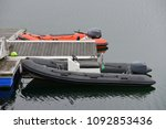 inflatable boat with a motor on ...   Shutterstock . vector #1092853436