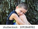little boy rests his head...   Shutterstock . vector #1092868982