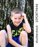 beaming little boy smiles as he ...   Shutterstock . vector #1092874646