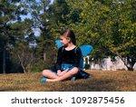little girl sits outside alone. ...   Shutterstock . vector #1092875456
