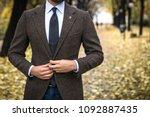 man in custom tailored suit... | Shutterstock . vector #1092887435