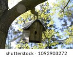 Small photo of Old wooden birdhouse in spring needs a coat of paint