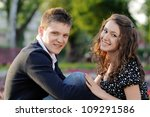 a smiling couple sitting  in... | Shutterstock . vector #109291586