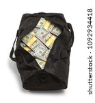 Small photo of Black Duffel Bag Full of Money Isolated on a White Background.