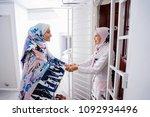 two young muslim women embrace...   Shutterstock . vector #1092934496