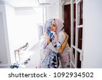 two young muslim women embrace... | Shutterstock . vector #1092934502