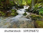 Mountain River Flowing At...