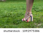 legs of woman wearing high heel ... | Shutterstock . vector #1092975386