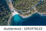 aerial view of marble beach.... | Shutterstock . vector #1092978122