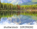 Reflection In Smooth Water Of...