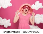 fashionable girl posing on a... | Shutterstock . vector #1092991022