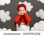 girl playing with clouds ... | Shutterstock . vector #1092991256