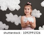 girl holding a cloud in her... | Shutterstock . vector #1092991526