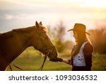 cowgirl and horse | Shutterstock . vector #1093036532
