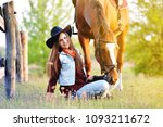 cowgirl and horse | Shutterstock . vector #1093211672