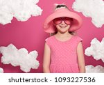 fashionable girl posing on a... | Shutterstock . vector #1093227536