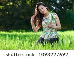 beautiful girl sitting on a... | Shutterstock . vector #1093227692