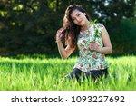 beautiful girl sitting on a... | Shutterstock . vector #1093227692