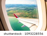 view from airplane window to... | Shutterstock . vector #1093228556