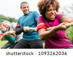 team competing in tug of war | Shutterstock . vector #1093262036