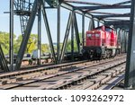 Small photo of Regensburg, Bavaria, Germany, April 20, 2018: A locomotive of the German Federal Railway on a railway bridge