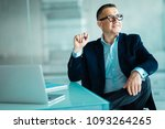 mature businessman writing on... | Shutterstock . vector #1093264265