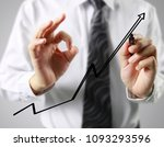 businessman drawing graphics a... | Shutterstock . vector #1093293596