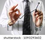 businessman drawing graphics a... | Shutterstock . vector #1093293602