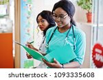 two african american pharmacist ... | Shutterstock . vector #1093335608