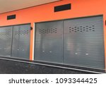 rolling shutter door of... | Shutterstock . vector #1093344425
