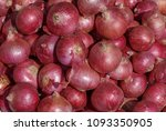 heap of red onion on market | Shutterstock . vector #1093350905