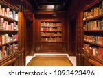 Small photo of BRUSSELS, BELGIUM - APR 2: Bookshelves with old volumes of books and antiquewooden table inside the Royal Library on April 2, 2018. More than 1,200,000 people lives in Brussels