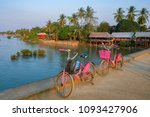 two pink bicycles on a bridge... | Shutterstock . vector #1093427906