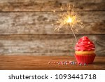 delicious birthday cupcake with ...   Shutterstock . vector #1093441718