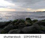 the wave breaking on stony beach | Shutterstock . vector #1093494812
