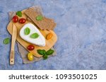Briquette curd cheese with tomatoes, toast and Basil. Selective focus.