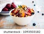 salad with muesli and fruits | Shutterstock . vector #1093503182