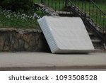 old mattress sitting outside on ... | Shutterstock . vector #1093508528