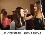 make up artist doing... | Shutterstock . vector #1093555925