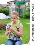 portrait of little girl playing ...   Shutterstock . vector #1093579286